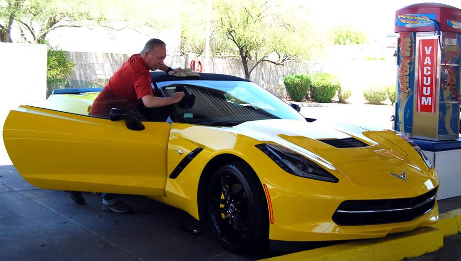 man washing corvette